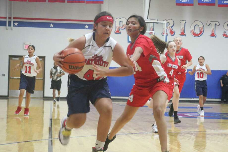 A Bondy ballhandler tries to figure out a way to get by Siannah Nava, Lake Jackson's one girl wrecking crew. Nava scored 14 second-half points, spoling Bondy's bid to get into the Silver bracket. Photo: Robert Avery