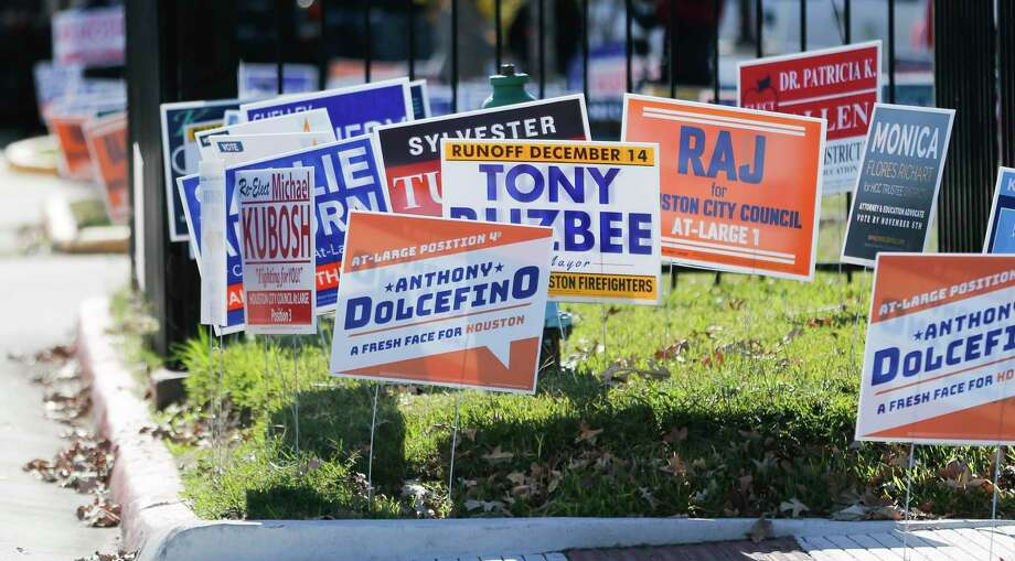 Political signs outside of Metropolitan Multi Service Center in Houston on Monday, Dec. 2, 2019, as voters make their way to the polls for early voting. Photo: Elizabeth Conley, Houston Chronicle / Staff Photographer / © 2018 Houston Chronicle