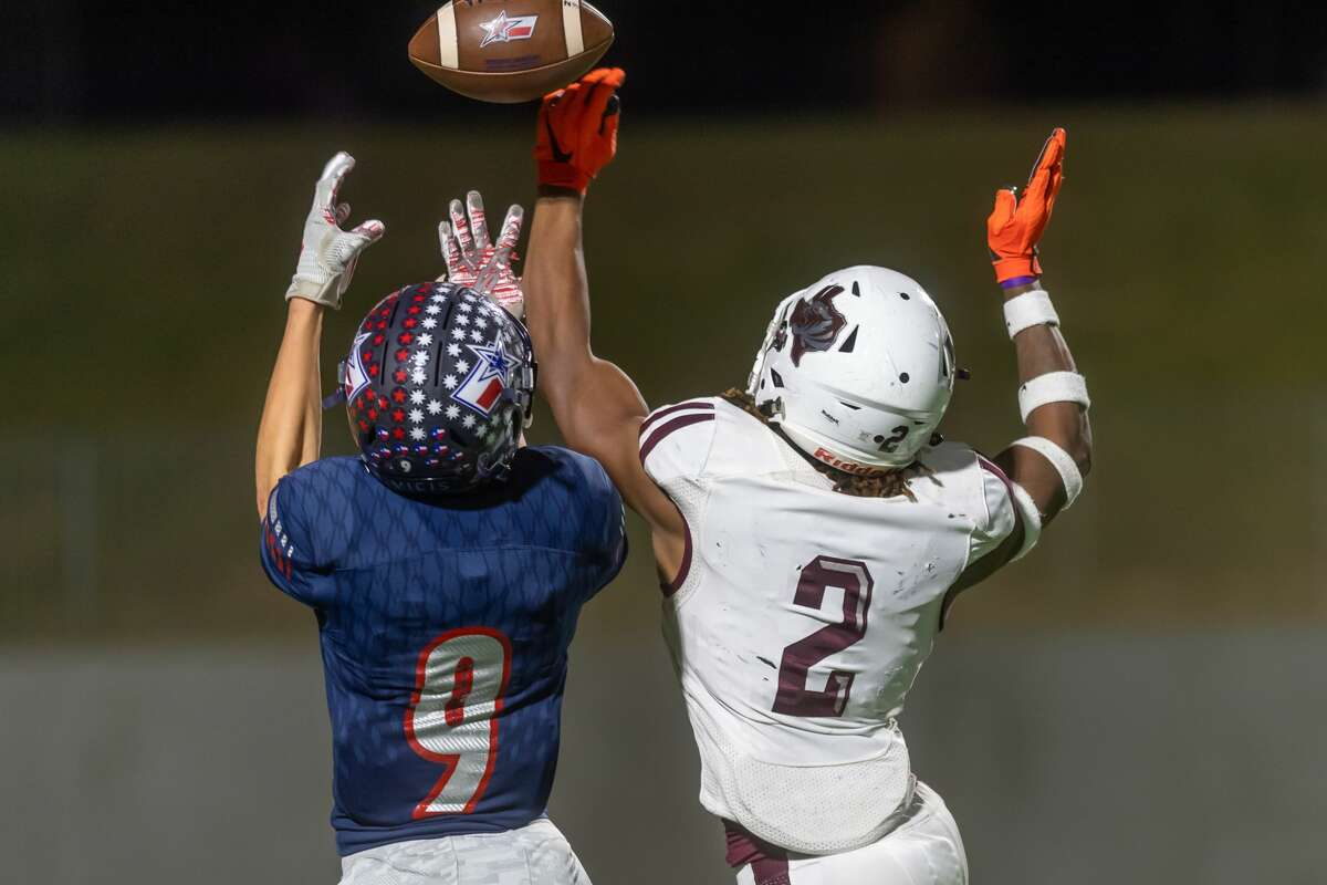 Silsbee defender Chris Martin (2) attempts to break up a pass play to Wimberley's Christian Marshall (9) in the first half of the state semifinal game as the Tigers played the Wimberley Texans at Legacy Stadium in Katy, Texas on Friday, December 13, 2019. Fran Ruchalski/The Enterprise