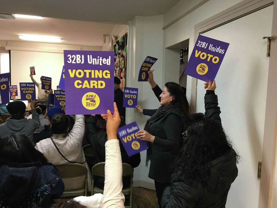 Members of 32BJ SEIU, a union of Connecticut building cleaners, voted Dec. 14, 2019 at the People's Center in New Haven to authorize a strike if their demands were not met in contract negotiations. Though New Haven County workers ratified a contract on Dec. 21, a strike was still on the table for more than a thousand workers in Fairfield County, a union spokesman said. Photo: Meghan Friedmann / Hearst Connecticut Media