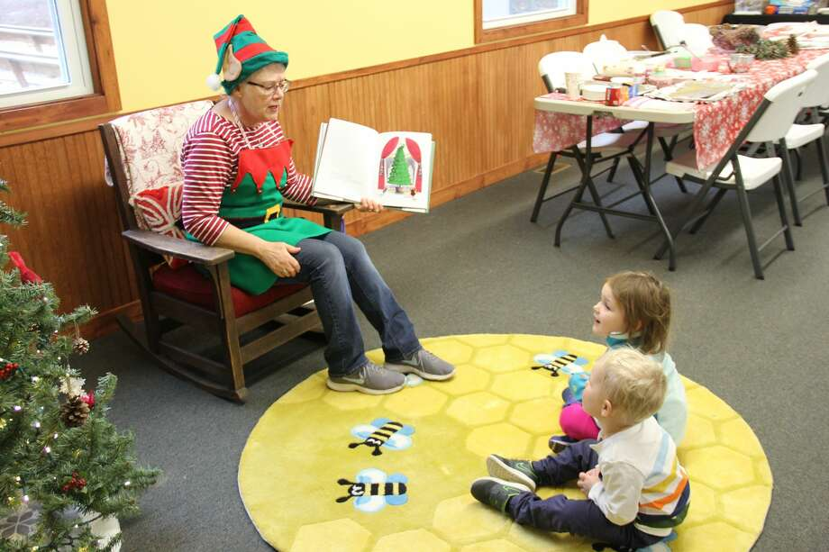 The Huron County Nature Center hosted its first Winter Celebration on Saturday. Attendees could get into the Christmas spirit by making decorating cookies, making homemade decorations, listening to Christmas stories, and meeting Santa Claus. Photo: Robert Creenan/Huron Daily Tribune