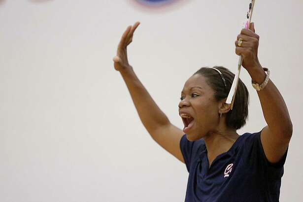 Clear Lake Falcons head coach Chanda Eager celebrates during a 2013 volleyball match against Friendswood.