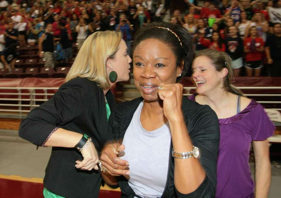 Clear Lake volleyball coach Chanda Eager celebrates a regional championship victory over Clear Falls in 2012. Photo: Kar B Hlava / The Broadcaster / The Broadcaster