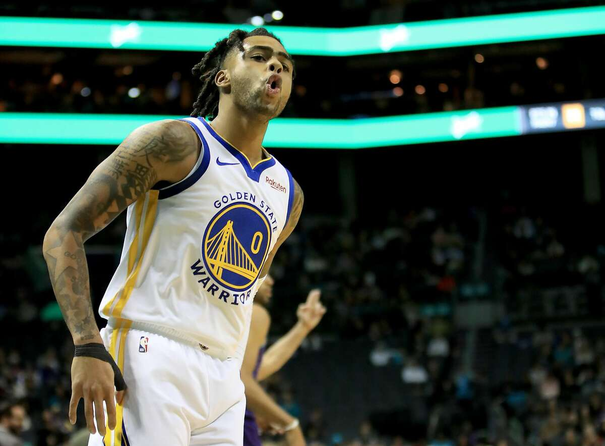 D'Angelo Russell #0 of the Golden State Warriors reacts after making a basket against the Charlotte Hornets during their game at Spectrum Center on December 04, 2019 in Charlotte, North Carolina. NOTE TO USER: User expressly acknowledges and agrees that, by downloading and or using this photograph, User is consenting to the terms and conditions of the Getty Images License Agreement. (Photo by Streeter Lecka/Getty Images)