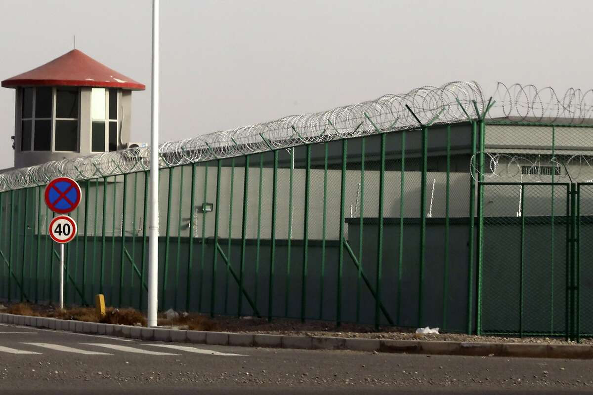 FILE.- In this Monday, Dec. 3, 2018, file photo, a guard tower and barbed wire fences are seen around a section of the Artux City Vocational Skills Education Training Service Center in Artux in western China's Xinjiang region. This is one of a growing number of internment camps in the Xinjiang region, where by some estimates over 1 million Muslims have been detained, forced to give up their language and their religion and subject to political indoctrination. Confidential documents, leaked to a consortium of news organizations, lay out the Chinese government's deliberate strategy to lock up ethnic minorities to rewire their thoughts and even the language they speak. One of the documents says that internment camps - such as the one in Artux - are to install guard towers, as well as other security measures to