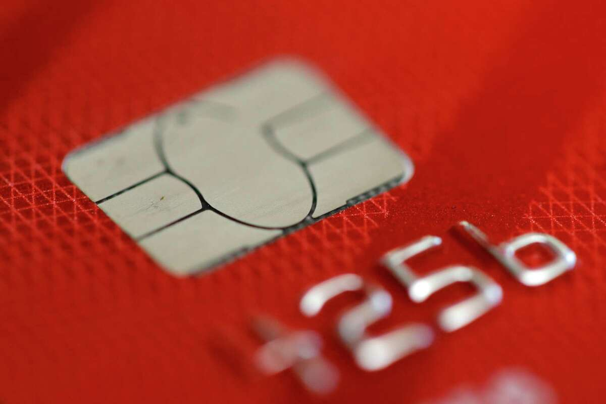 FILE - This June 10, 2015, file photo shows a credit card in Philadelphia. While banking customers have likely heard of high-yield online savings accounts, less familiar is a relatively new product that has come into its own only this year: the cash management account. (AP Photo/Matt Rourke, File)