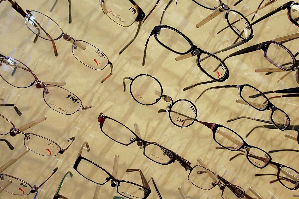 FILE - In this Tuesday, June 12, 2012, file photo, eyeglass frames are displayed at Berlin Optical Expressions in Berlin, Vt. Worrying what to do with your flexible spending account balance so you don't lose your money? Out-of-pocket costs for corrective eye surgery, prescription eyeglasses, readers, wipes and repair kits for glasses, and contact lenses and solutions are covered. (AP Photo/Toby Talbot, File)