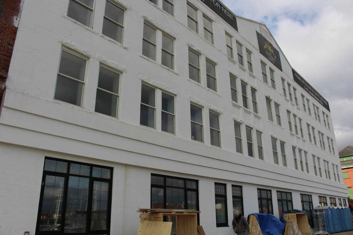 Contractors are putting the finishing touches in the Jayson building across from the Post on Middle Street whichdevelopers said is slated to open by January.