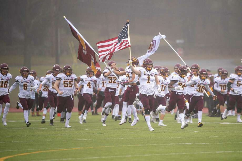 Sheehan Titans take the field for the 2019 CIAC Class S Championship Photo: David G. Whitham / For Hearst Connecticut Media / Stamford Advocate Freelance