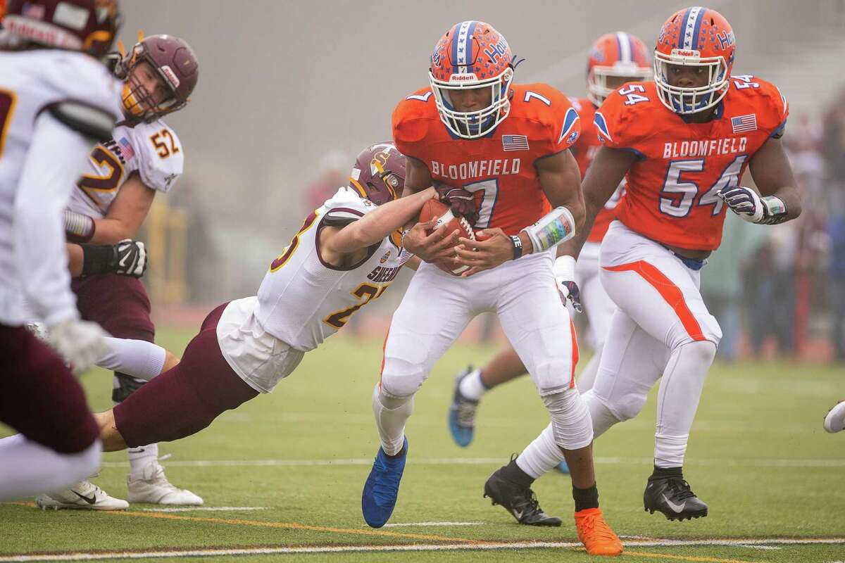 Bloomfield's Brandon Bish struggles for yardage against Sheehan high during the CIAC Class S Championship game, December 14, 2019 at Trumbull High School