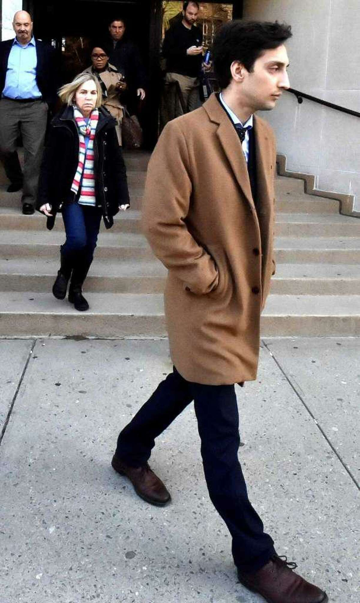 Saifullah Khan leaves Superior Court in New Haven in 2017.