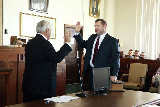 Justin Johnston at his swearing-in ceremony in January of 2017. Just two months later, he would be fighting for his life after being struck by a Cleveland man while working an extra job on TX 146. Johnston will not seek re-election to his job.