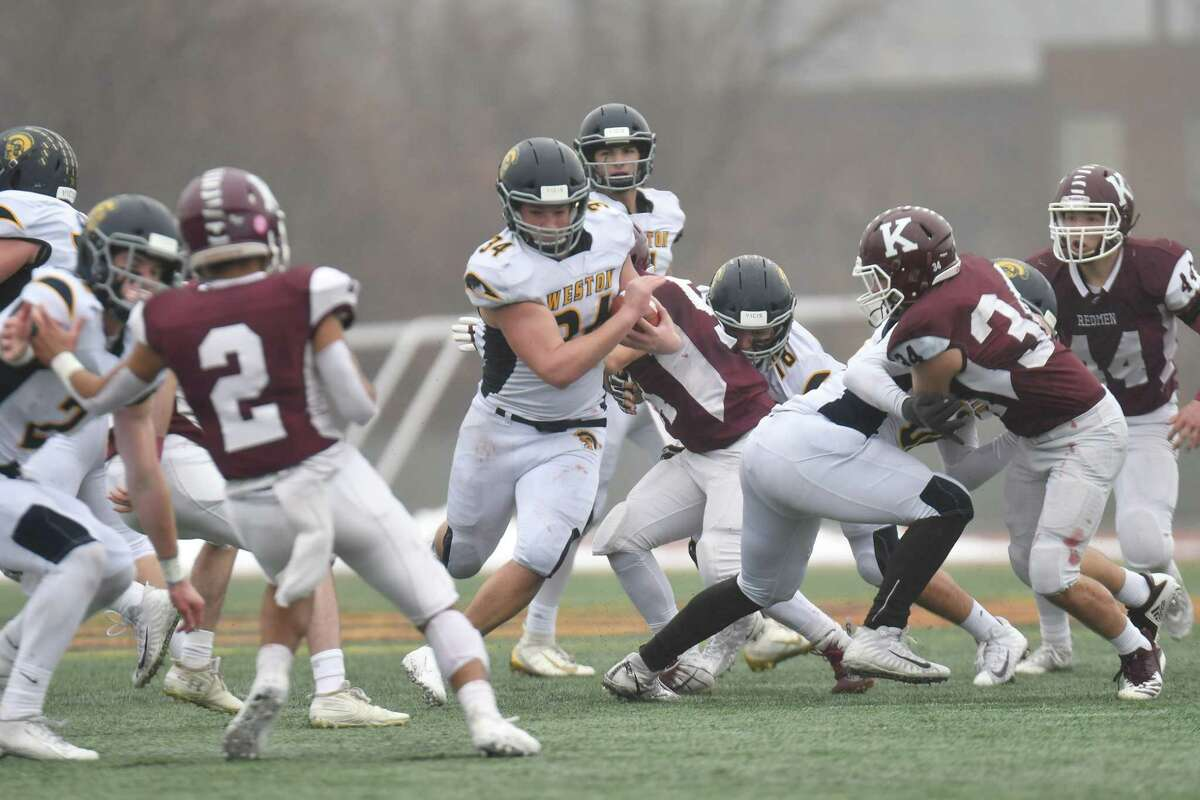 Football action of the CIAC Class M Football Championship between the Weston Trojans and Killingly played on Saturday Dec 14 ,2019 at Veterans Stadium in New Britain, Connecticut.