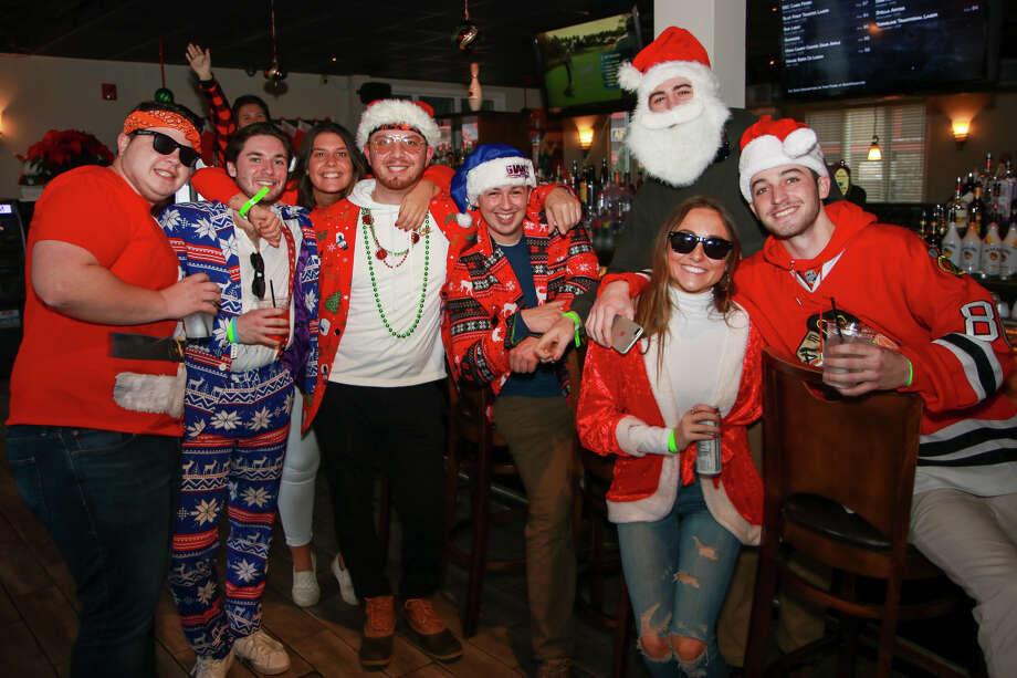 Santas swarmed the streets of Milford during the annual SantaCon bar crawl on December 14, 2019. Were you SEEN? Photo: Ken (Direct Kenx) Honore / CT Hearst Media