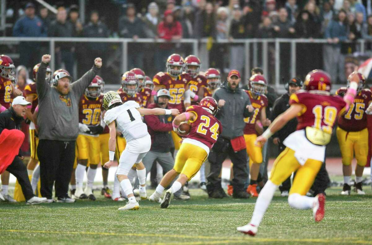 St. Joseph's Kral Preston (24) returns an interception in the second quarter against Hand for a touchdown in the CIAC Class L state championship football game at Veterans Memorial Stadium in New Britian, Connecticut on Dec. 14, 2019.