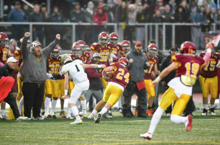 St. Joseph's Kral Preston (24) returns an interception in the second quarter against Hand for a touchdown in the CIAC Class L state championship football game at Veterans Memorial Stadium in New Britian, Connecticut on Dec. 14, 2019. Photo: Matthew Brown / Hearst Connecticut Media / Stamford Advocate