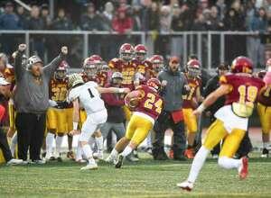 St. Joseph's Kral Preston (24) returns an interception for a touchdown against Hand in the CIAC Class L state championship on Dec. 14.