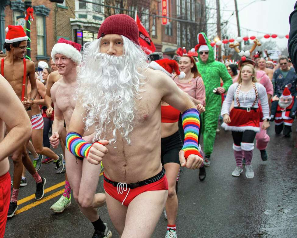 Runners in the 14th Annual Santa Speedo Sprint on Lark Street in Albany, New York, to benefit the Albany Damien Center and the HIV/AIDS program at Albany Medical Center Hospital on Saturday, Dec. 14, 2019 (Jim Franco/Special to the Times Union.)