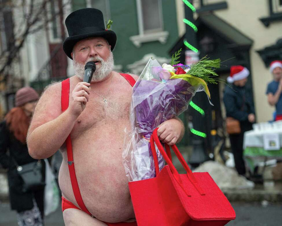 Jim Larson, organizer of the 14th Annual Santa Speedo Sprint on Lark Street in Albany, New York, on Saturday, Dec. 14, 2019, thanks everyone who helped support the Albany Damien Center and the HIV/AIDS program at Albany Medical Center Hospital (Jim Franco/Special to the Times Union.)