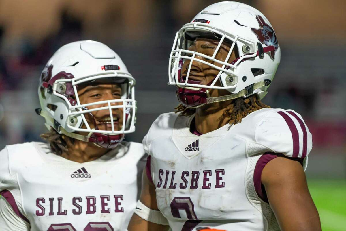 Silsbee's Antonius Arline (29) and Chris Martin (2) celebrate Martin's touchdown near the end of the first half of the state semifinal game as the Tigers played the Wimberley Texans at Legacy Stadium in Katy, Texas on Friday, December 13, 2019. Fran Ruchalski/The Enterprise