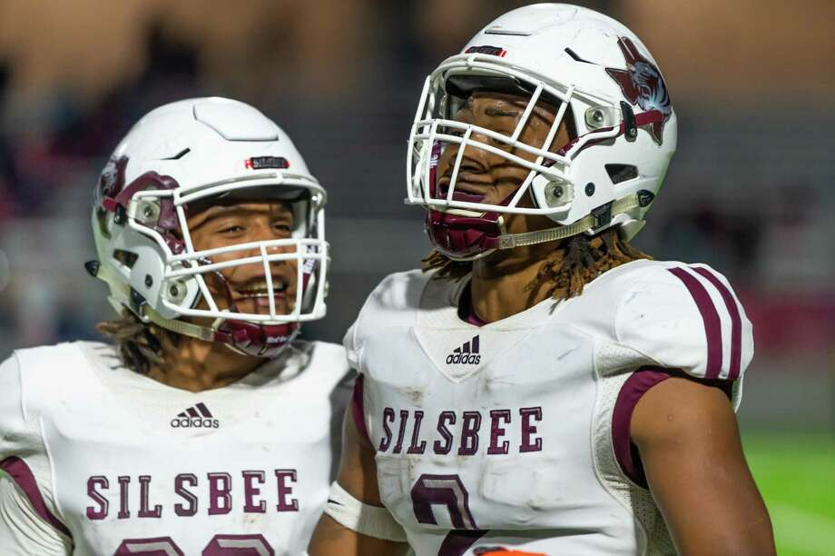 Silsbee's Antonius Arline (29) and Chris Martin (2) celebrate Martin's touchdown near the end of the first half of the state semifinal game as the Tigers played the Wimberley Texans at Legacy Stadium in Katy, Texas on Friday, December 13, 2019. Fran Ruchalski/The Enterprise Photo: Fran Ruchalski/The Enterprise