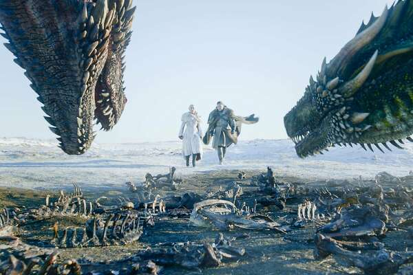 """This image released by HBO shows Emilia Clarke, left, and Kit Harington in a scene from the final episode of """"Game of Thrones."""" Although Kit Harington was nominated for a Golden Globe for best actor in a drama series, the final season of the series failed to get a nomination for best drama series. (HBO via AP)"""