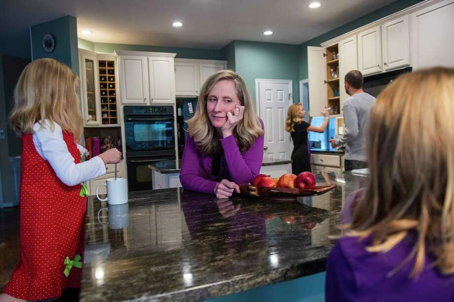 Rep. Abigail Spanberger, D-Va., spends time with her husband and daughters at their Glen Allen home, where campaign mementos keep Spanberger's job front and center. Photo: Photo By Amanda Voisard For The Washington Post / For The Washington Post