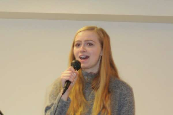 Madelyn Aug, who lives in Sandy Hook and goes to WestConn, sang 'Rise Up' at Ridgefield's Sandy Hook remembrance observances on Saturday, Dec. 14, the seventh anniversary of 2012 shooting at Sandy Hook Elementary School in Newtown.