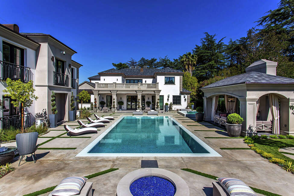 Grammy-winning producer Philip Lawrence shelled out $10.55 million for the Encino home of former Dodger Jimmy Rollins. The neoclassical-inspired home sits behind gates on more than half an acre with a sports court, a resort-style swimming pool and a guesthouse. A wine cellar, an indoor sauna and a grand domed entry are among features of the 14,900-square-foot mansion, which was built in 2017. (Daniel Dahler/TNS)