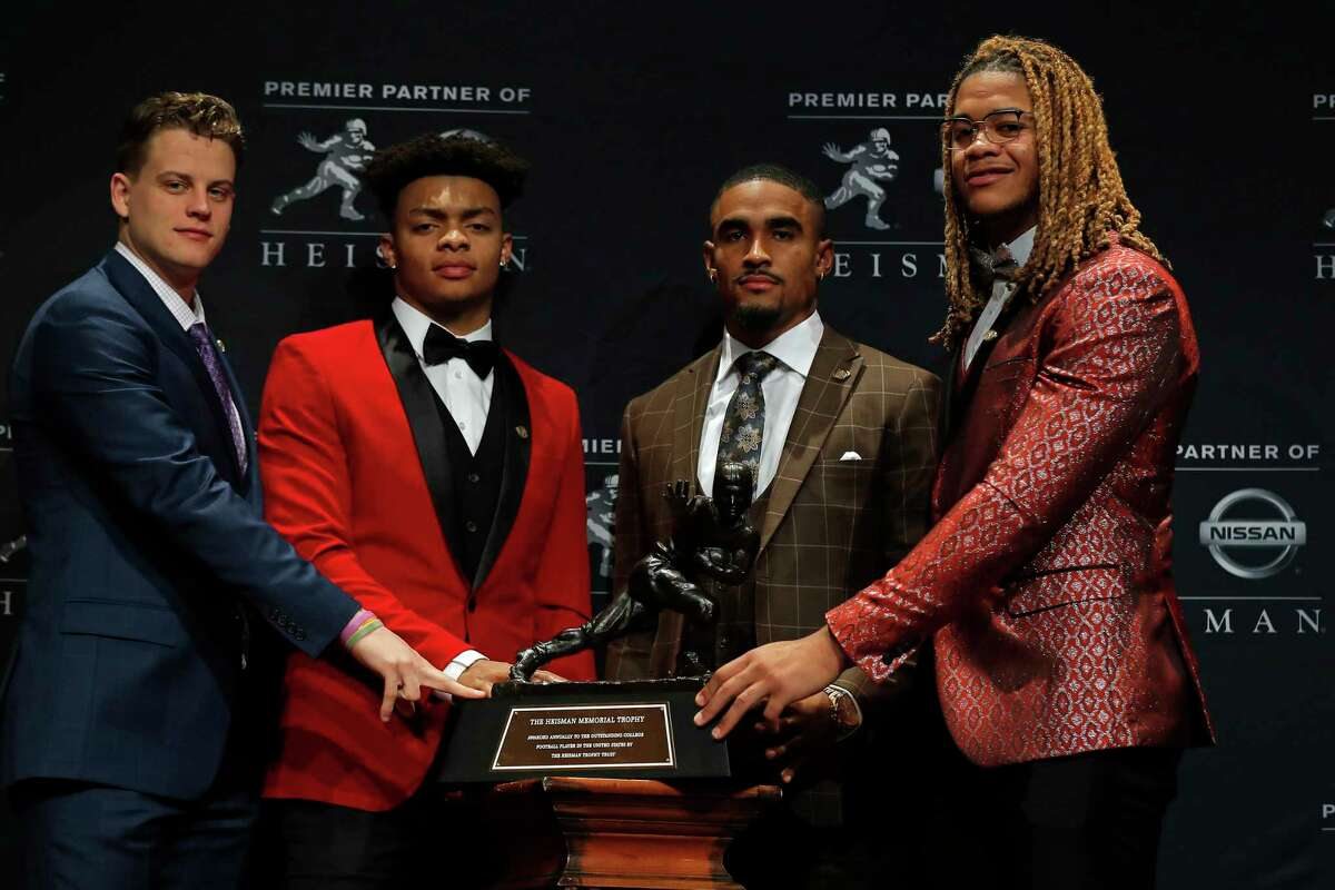 NEW YORK, NY - DECEMBER 14: (L-R) Finalists for the 85th annual Heisman Memorial Trophy, quarterback Joe Burrow of the LSU Tigers, quarterback Justin Fields of the Ohio State Buckeyes, quarterback Jalen Hurts of the Oklahoma Sooners and defensive end Chase Young of the Ohio State Buckeyes pose for a picture on December 14, 2019 in New York City.
