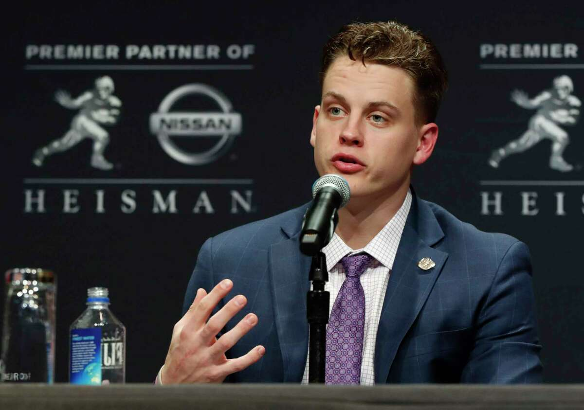 NCAA college football player and Heisman Trophy finalist, LSU quarterback Joe Burrow talks to the media during a press conference before the Heisman Trophy ceremony, Saturday, Dec. 14, 201, in New York. (AP Photo/Jason Szenes)