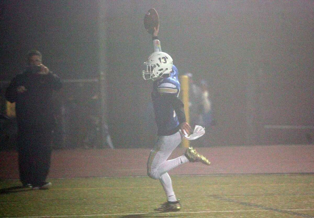 Newtown's Riley Ward catches a touchdown pass to win the game against Darien in the Class LL championship game on Dec. 14.