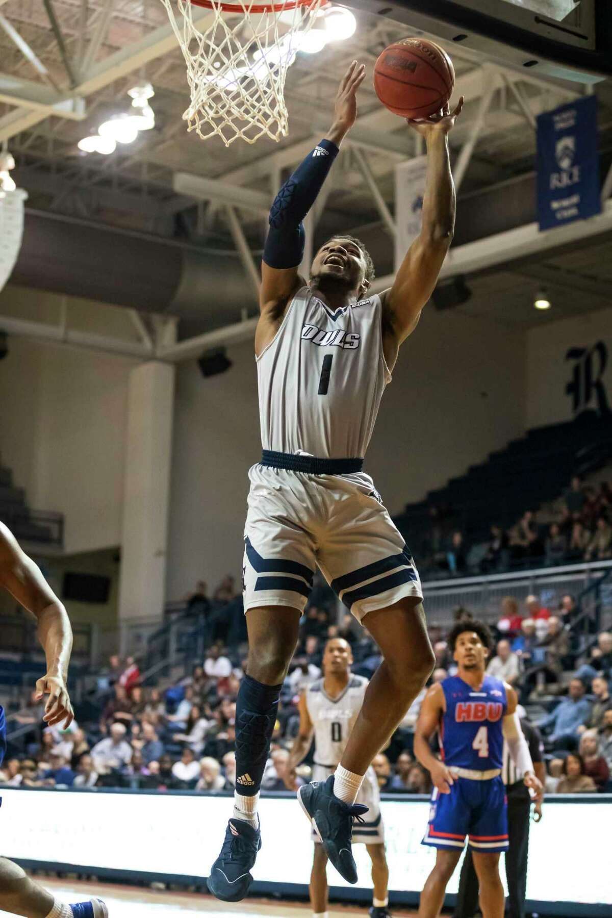 Rice guard Josh Parrish (1) goes up for a layup in the first half of a college basketball game Saturday, Dec 14, 2019, in Houston.