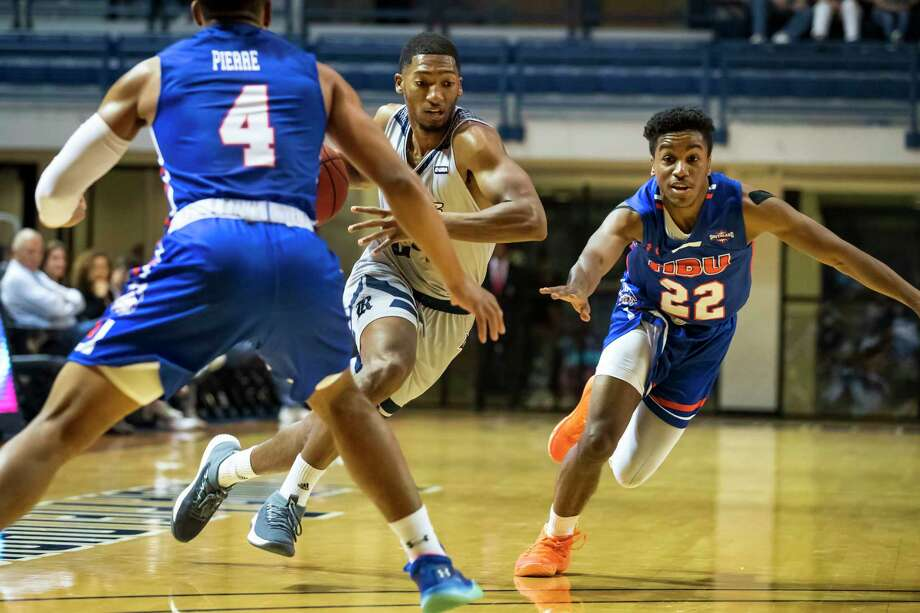 Rice guard Chris Mullins (24) dribbles past Houston Baptist guard Jason Gates (22) and Myles Pierre (4) in the first half of a college basketball game Saturday, Dec 14, 2019, in Houston. Photo: Joe Buvid, Contributor / © 2019 Joe Buvid