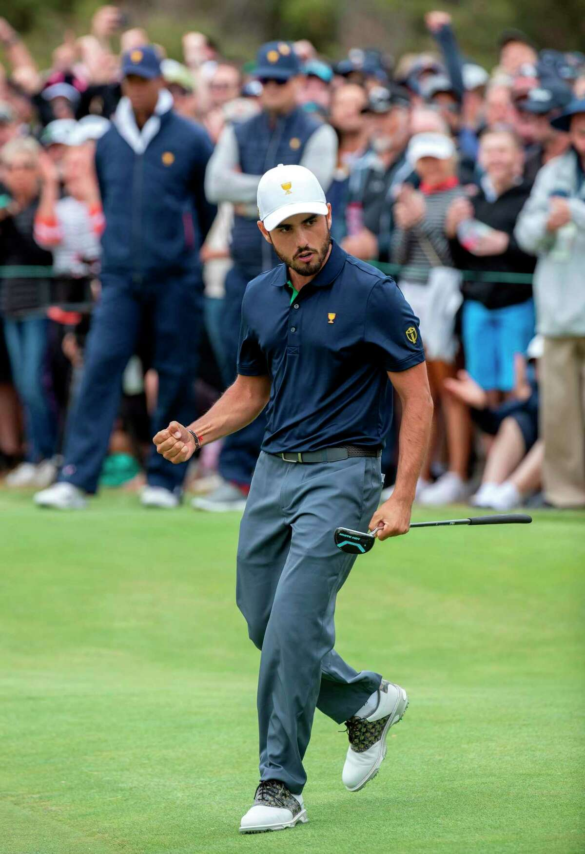 International team member Abraham Ancer of Mexico celebrates sinking a putt to win his match during the Presidents Cup golf tournament in Melbourne on December 14, 2019. (Photo by SIMON BAKER / AFP) / -- IMAGE RESTRICTED TO EDITORIAL USE - STRICTLY NO COMMERCIAL USE -- (Photo by SIMON BAKER/AFP via Getty Images)