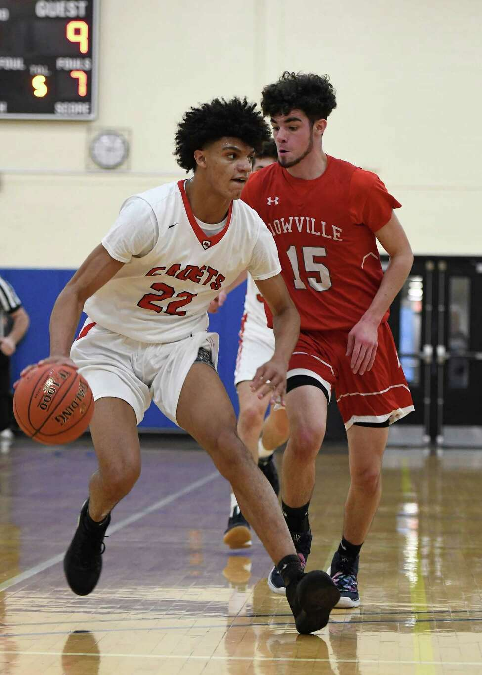 Albany Academy's Andre Jackson dribbles the ball past Lowville's Aiden Zehr during a coaches versus cancer tournament game at Fulton-Montgomery Community College in Johnstown, N.Y., on Saturday, Dec. 14, 2019. (Jenn March, Special to the Times Union)