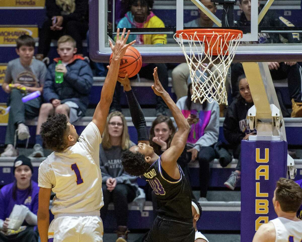 UAlbany sophomore Malachi deSousa is called for a foul after blocking the shot of Niagara University sophomore Marcus Hammond at the SEFCU Arena in Albany, New York, on Saturday, Dec. 14, 2019 (Jim Franco/Special to the Times Union.)