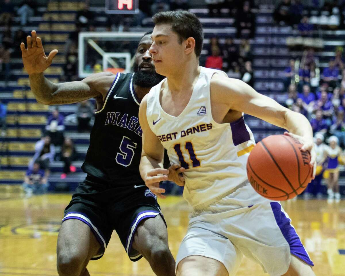 UAlbany sophomore Cameron Healy drives by Niagara University senior James Towns at the SEFCU Arena in Albany, New York, on Saturday, Dec. 14, 2019 (Jim Franco/Special to the Times Union.)