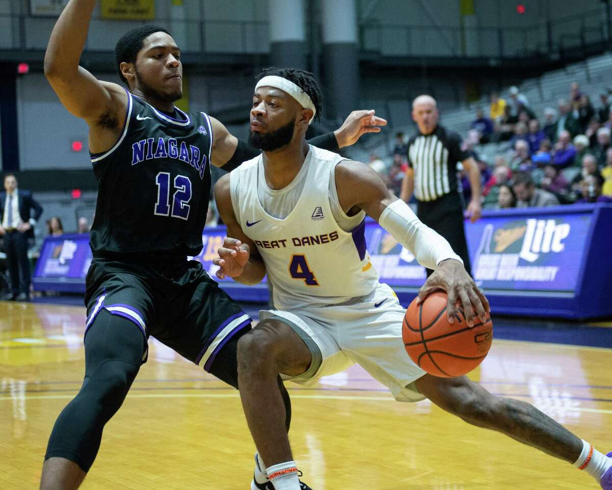 UAlbany senior Ahmad Clark tries to get by Niagara University sophomore Shandon Brown at the SEFCU Arena in Albany, New York, on Saturday, Dec. 14, 2019 (Jim Franco/Special to the Times Union.)