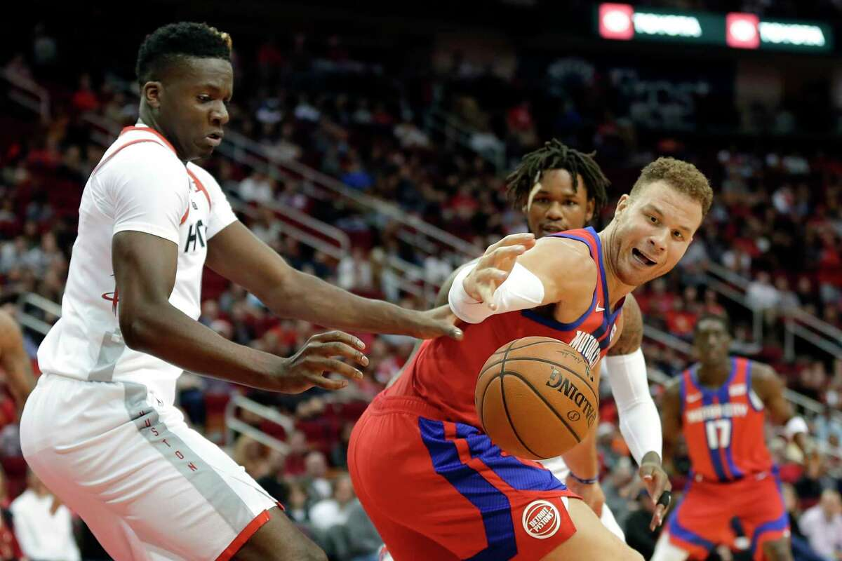 Detroit Pistons forward Blake Griffin, right, loses the ball under pressure from Houston Rockets center Clint Capela, left, during the first half of an NBA basketball game Saturday, Dec. 14, 2019, in Houston. (AP Photo/Michael Wyke)