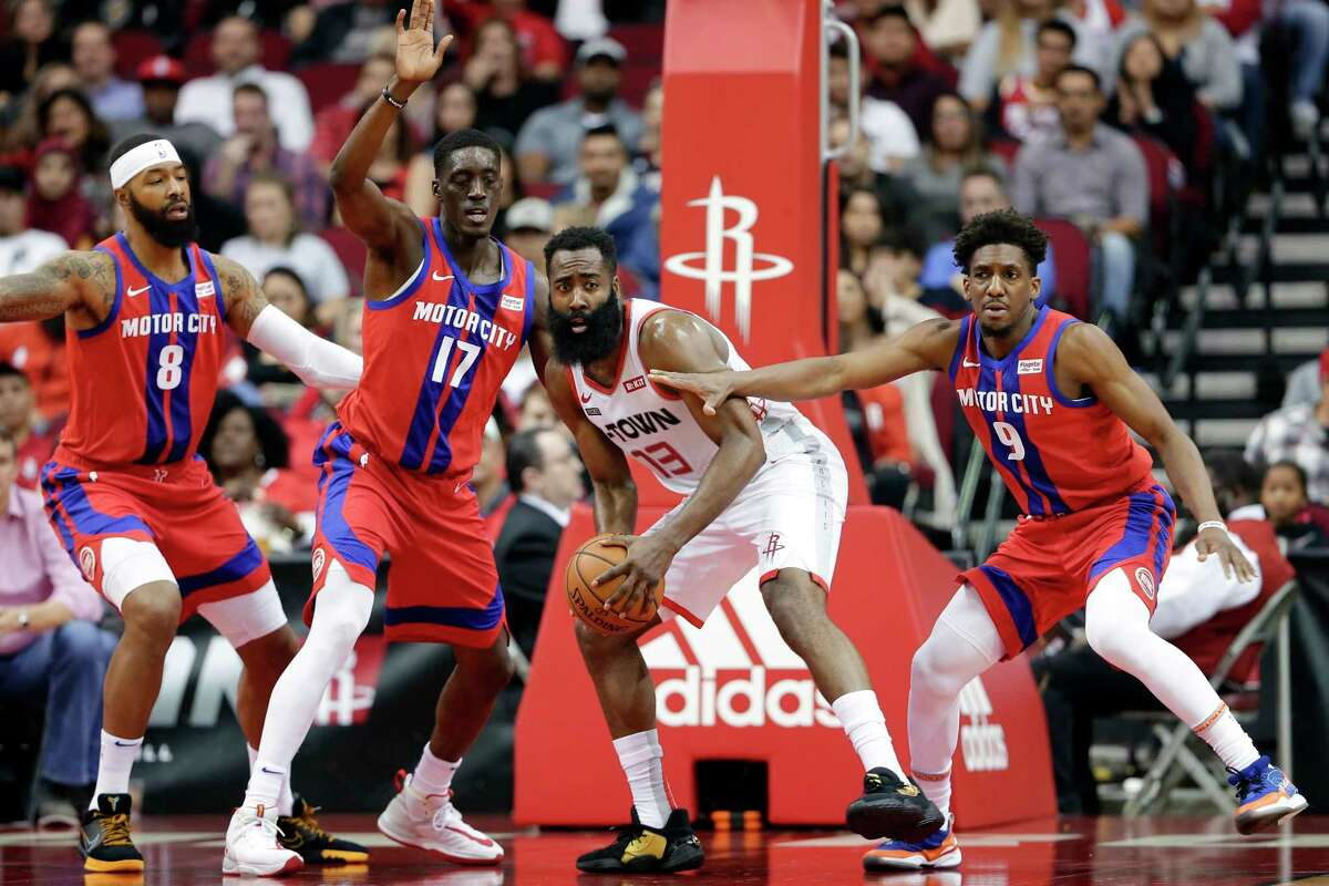 Houston Rockets guard James Harden (13) searches to pass the ball from between Detroit Pistons forward Markieff Morris (8), guard Tony Snell (17) and guard Langston Galloway (9) during the first half of an NBA basketball game Saturday, Dec. 14, 2019, in Houston. (AP Photo/Michael Wyke)