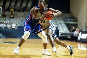 Rice guard Robert Martin (10) drives past Houston Baptist forward Benjamin Uloko (32) for a layup in the second half of a college basketball game Saturday, Dec 14, 2019, in Houston.