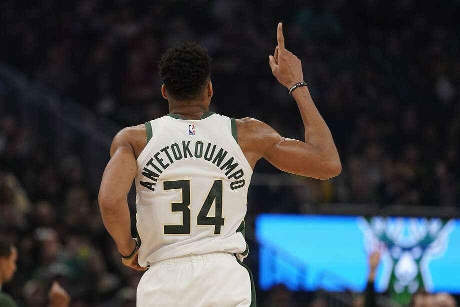 Giannis Antetokounmpo of Milwaukee scored 29 on the way to a win that put the Bucks a half-game ahead of the Los Angeles Lakers in the race for the league's best record. Photo: Morry Gash / Associated Press