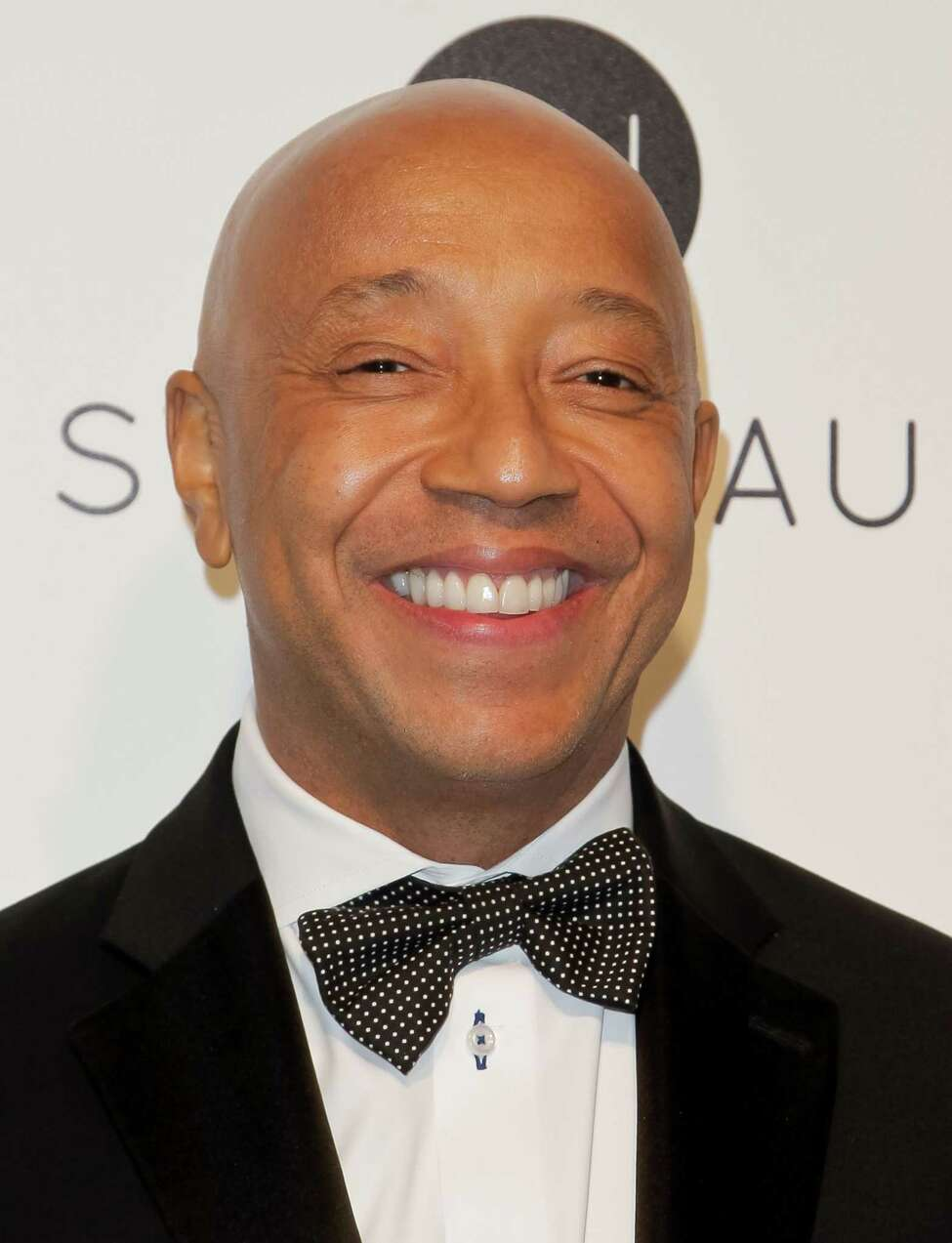 US entrepreneur and producer Russell Simmons poses upon his arrival for the 25th annual Elton John AIDS Foundation's Academy Awards Viewing Party on February 26, 2017 in West Hollywood, California. / AFP PHOTO / TIBRINA HOBSONTIBRINA HOBSON/AFP/Getty Images ORG XMIT: 1
