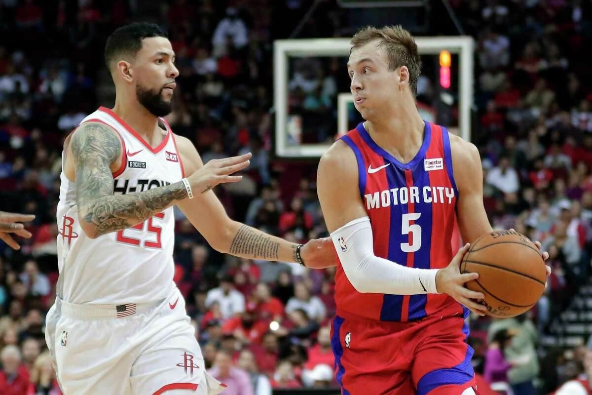 Detroit Pistons guard Luke Kennard (5) looks to pass the ball as Houston Rockets guard Austin Rivers (25) defends during the first half of an NBA basketball game Saturday, Dec. 14, 2019, in Houston. (AP Photo/Michael Wyke)