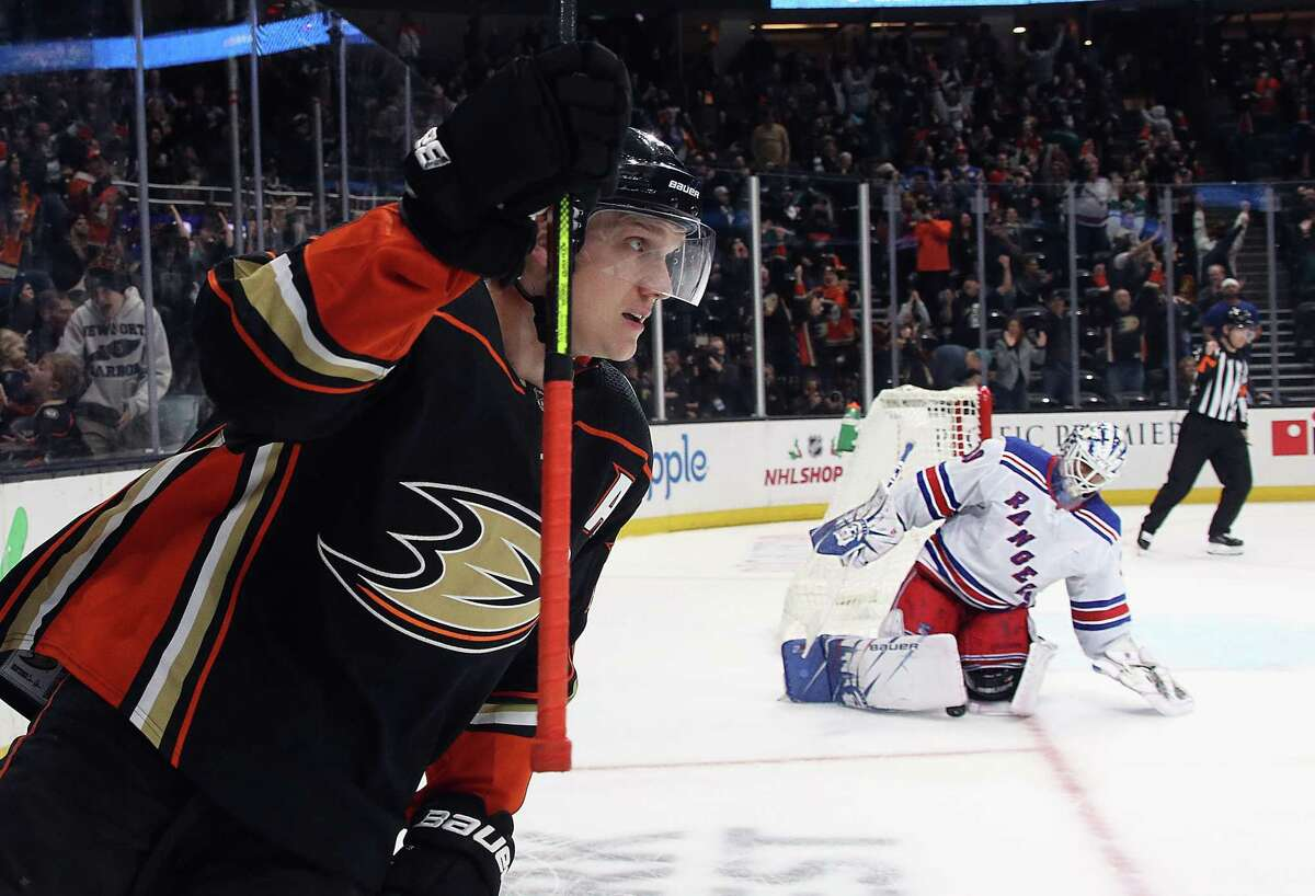 ANAHEIM, CALIFORNIA - DECEMBER 14: Jakob Silfverberg #33 of the Anaheim Ducks scores the game winning goal in the shoot-out against Henrik Lundqvist #30 of the New York Rangers at the Honda Center on December 14, 2019 in Anaheim, California. The Ducks defeated the Rangers 4-3 in the shoot-out. (Photo by Bruce Bennett/Getty Images)