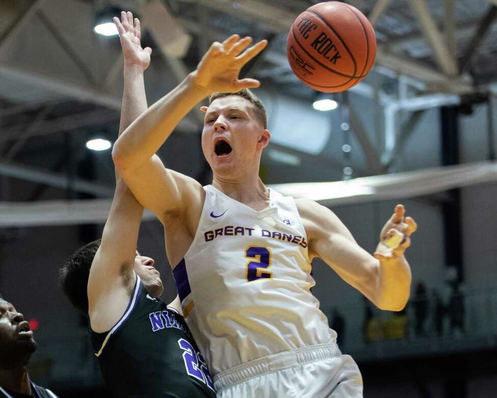 UAlbany freshman Trey Hutcheson drives to the basket in front of Niagara University freshman Nick McDonald at the SEFCU Arena in Albany, New York, on Saturday, Dec. 14, 2019 (Jim Franco/Special to the Times Union.)