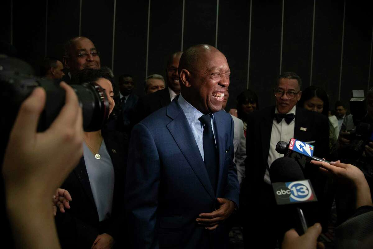 Mayor Sylvester Turner is all smiles as he talks to the press at his election watch party on Saturday, Dec. 14, 2019, in Houston.