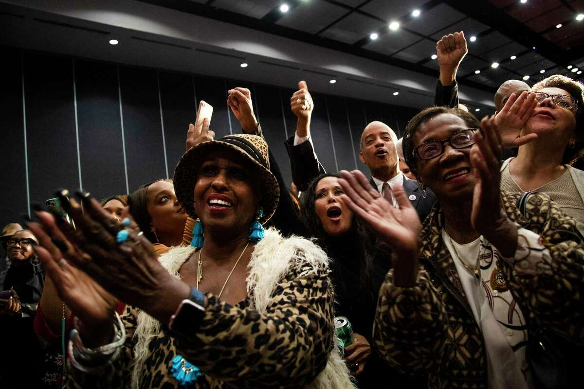 Mayor Sylvester Turner's supporters cheer for him as he takes the stage to thank his supporters during his campaign watch party on runoff election night on Saturday, Dec. 14, 2019, in Houston.