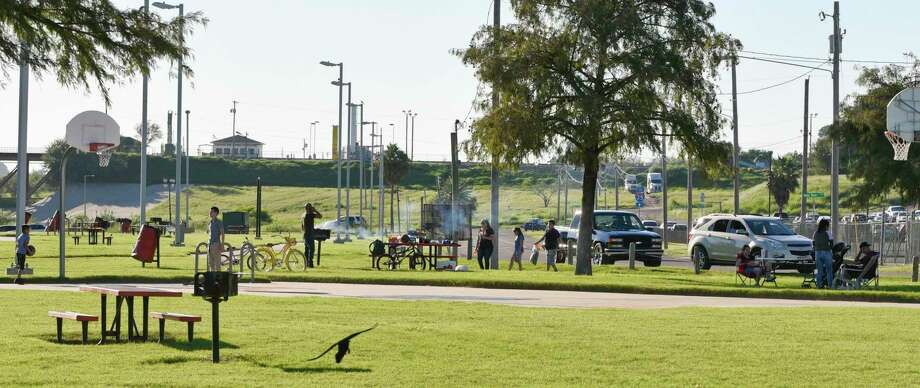 A family has a quiet cookout at Tres Laredos Park, just several yards away from the Rio Grande, on Nov. 3, 2018. The federal government is offering to compromise with Laredo City Council to build a more aesthetically appealing version of the wall in this area in exchange for their cooperation going forward. Photo: Danny Zaragoza /Laredo Morning Times File / Laredo Morning Times
